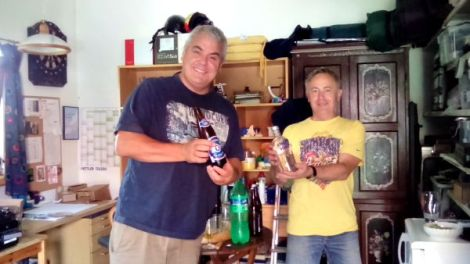 Jon and Othmar carefully checking out the beer and schnapps supplies.