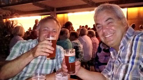 Ottmar and Jon sampling the home made beer in Gross Sankt Florian.